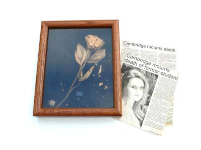 Dried Rose and Newspaper Clippings